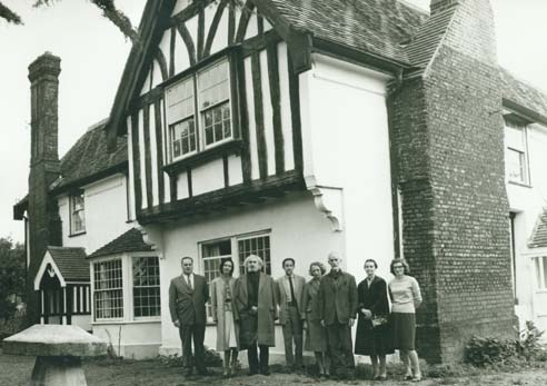 Photo of F. Clive Ross and group outside Pates Manor